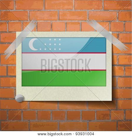 Flags Uzbekistan Scotch Taped To A Red Brick Wall