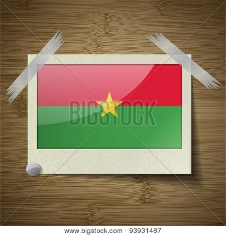 Flags Burkia Faso At Frame On Wooden Texture. Vector