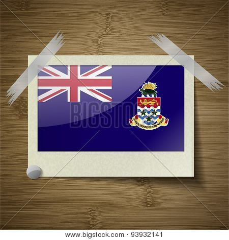 Flags Cayman Islands At Frame On Wooden Texture. Vector