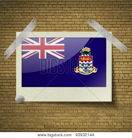 Flags Cayman Islands At Frame On A Brick Background. Vector