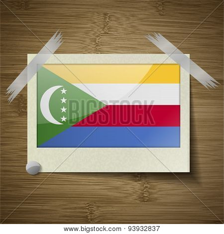Flags Comoros At Frame On Wooden Texture. Vector