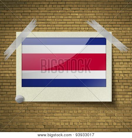 Flags Costa Rica At Frame On A Brick Background. Vector