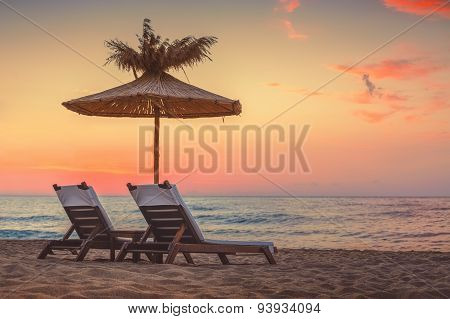 Vivid Sunrise On A Beautiful Sandy Beach With Sunshade