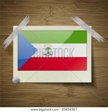 Flags Equatorial Guinea At Frame On Wooden Texture. Vector