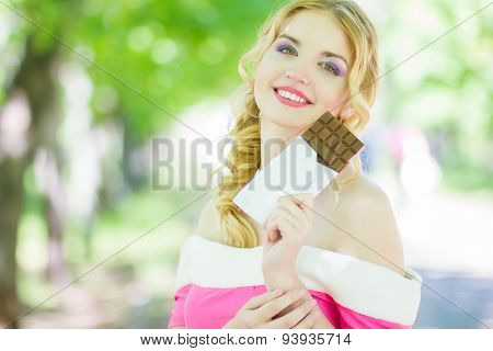 Portrait of a chocolate loving young blonde beauty