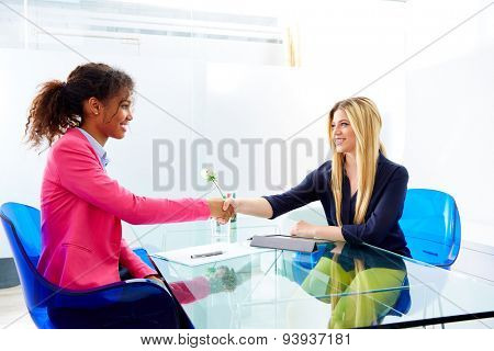 businesswomen interview handshake multi ethnic africand and blond sitting at office