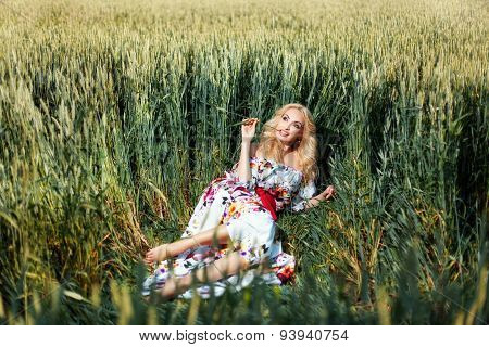 Girl Lies Rumpled Grass On The Field.