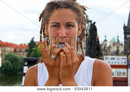 Woman playing a ceramic flute, Prague.