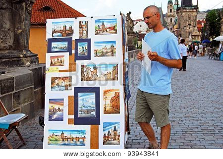 Tourist looking at souvenirs, Prague.