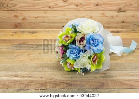 Artificial Flowers On Wooden Background