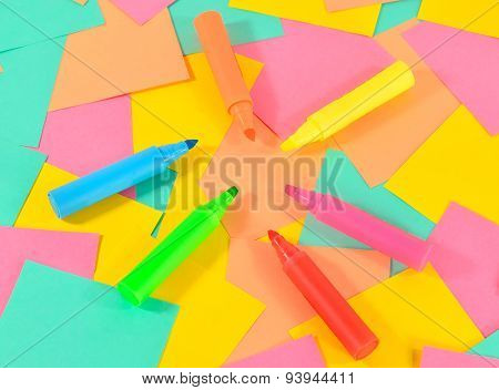 Colored markers on the colored cards background.