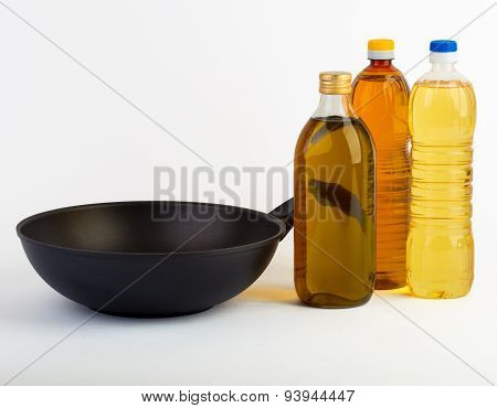 wok pan with bottles of oil