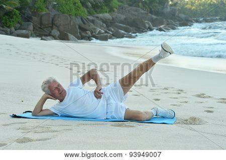 Happy Senior man exercising in summer