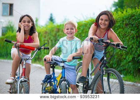 Portrait Of Three Little Cyclists