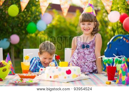 Birthday Party With Colorful Cake At Backyard