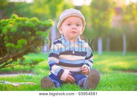 Little Boy Playing On Green Grass