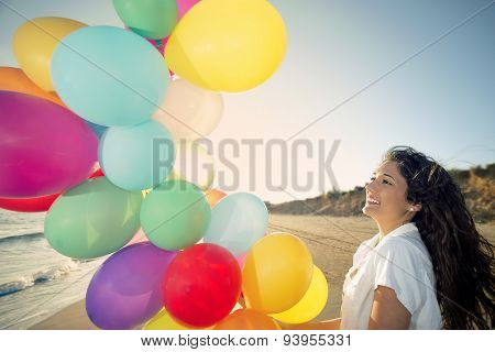 Happy Woman With Multi Colored Balloons