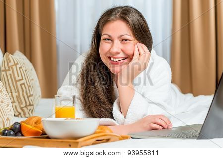 Beautiful And Happy Girl On The Bed With A Tray Of Food