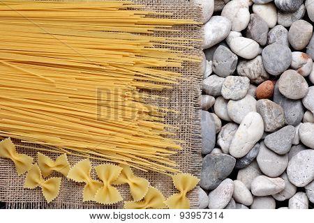 Spaghetti Farfalle On Burlap Fray