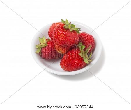 Strawberries With Tails On A Saucer. Isolated On White Background