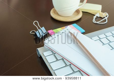 Notepad With Pencil In Workspace