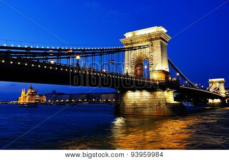 Chain Bridge And Hungarian Parliament Build In Budapest By Night
