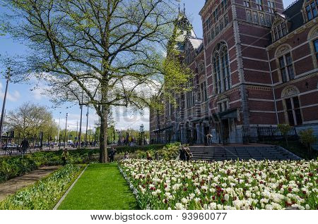Amsterdam, Netherlands - May 6, 2015: Tourists At The Garden Around The Rijksmuseum