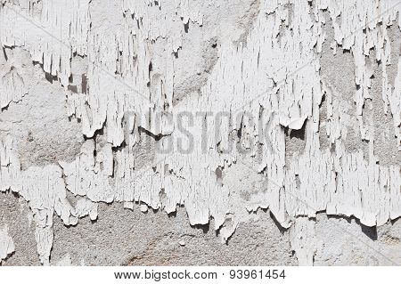 Vintage Flakes Of Old White Paint On Grey Concrete Wall