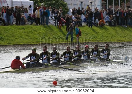 ST. PETERSBURG, RUSSIA - JUNE 12, 2015: Sweep rowing competition on eights boats during the Golden Blades Regatta. It is is one of the best known regatta in Russia