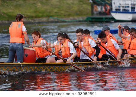 ST. PETERSBURG, RUSSIA - JUNE 12, 2015: Competition of Dragon boats during the Golden Blades Regatta. This kind of competitions make the race accessible for not only professional athletes but amateurs