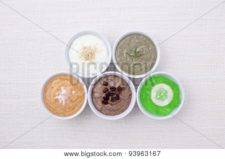 Variety Of Body Scrubs On Cotton Background