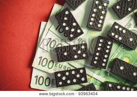 Money And Dominoes