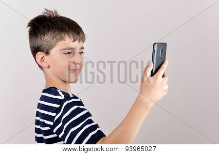 Young boy taking selfie
