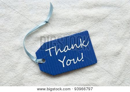 Thank You On Blue Label Sand Background