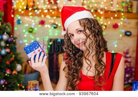 Beautiful Girl Holding A Christmas Gift