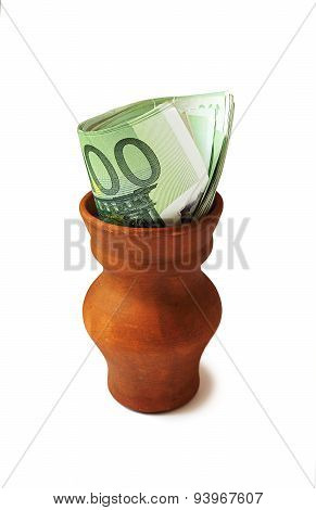 Clay Pot With Euro Bills. Isolated On White.