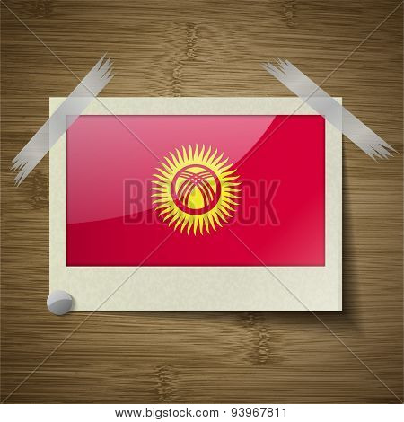 Flags Kyrgyzstan At Frame On Wooden Texture. Vector