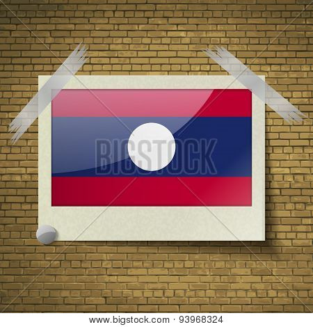 Flags Laos At Frame On A Brick Background. Vector