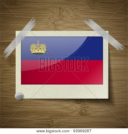 Flags Liechtenstein At Frame On Wooden Texture. Vector