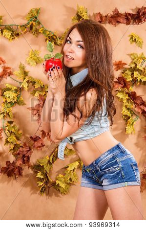 Beautiful Young Female Farmer Holding A Red Apple