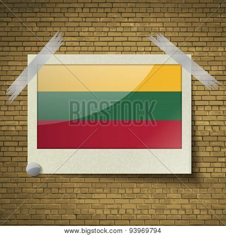 Flags Lithuania At Frame On A Brick Background. Vector