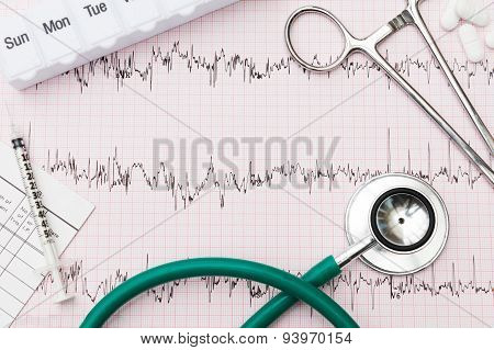 Medical Equipment Arranged On Pulse Trace Printout