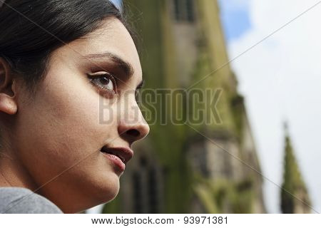 A young woman looks into the distance