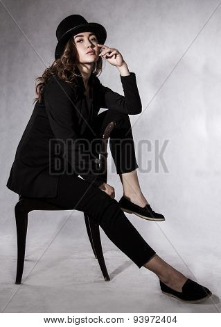 Beautiful Young Woman In A Black Hat And A Black Jacket