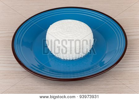 Granular Curd In Blue Glass Bowl