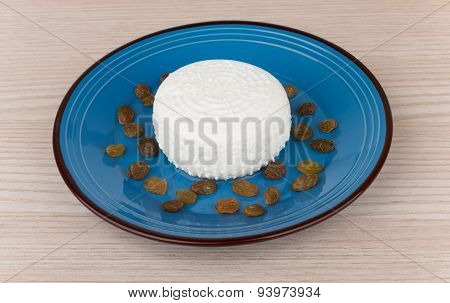 Granular Curd And Raisins In Blue Glass Bowl