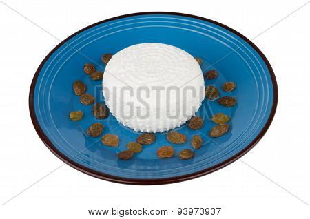 Granular Curd And Raisins In Blue Glass Bowl On White