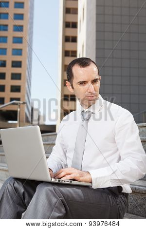 Business Man Sitting On Steps Using Laptop