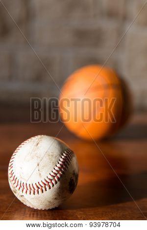 Baseball And Basketball On A Table