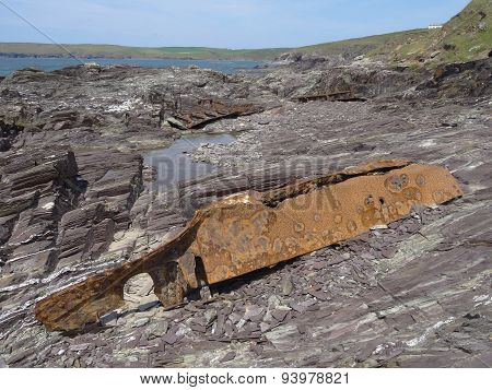 Boat Wreckage Upon Cliff Seascape